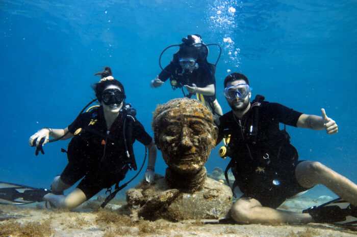 Dive with submerged statues